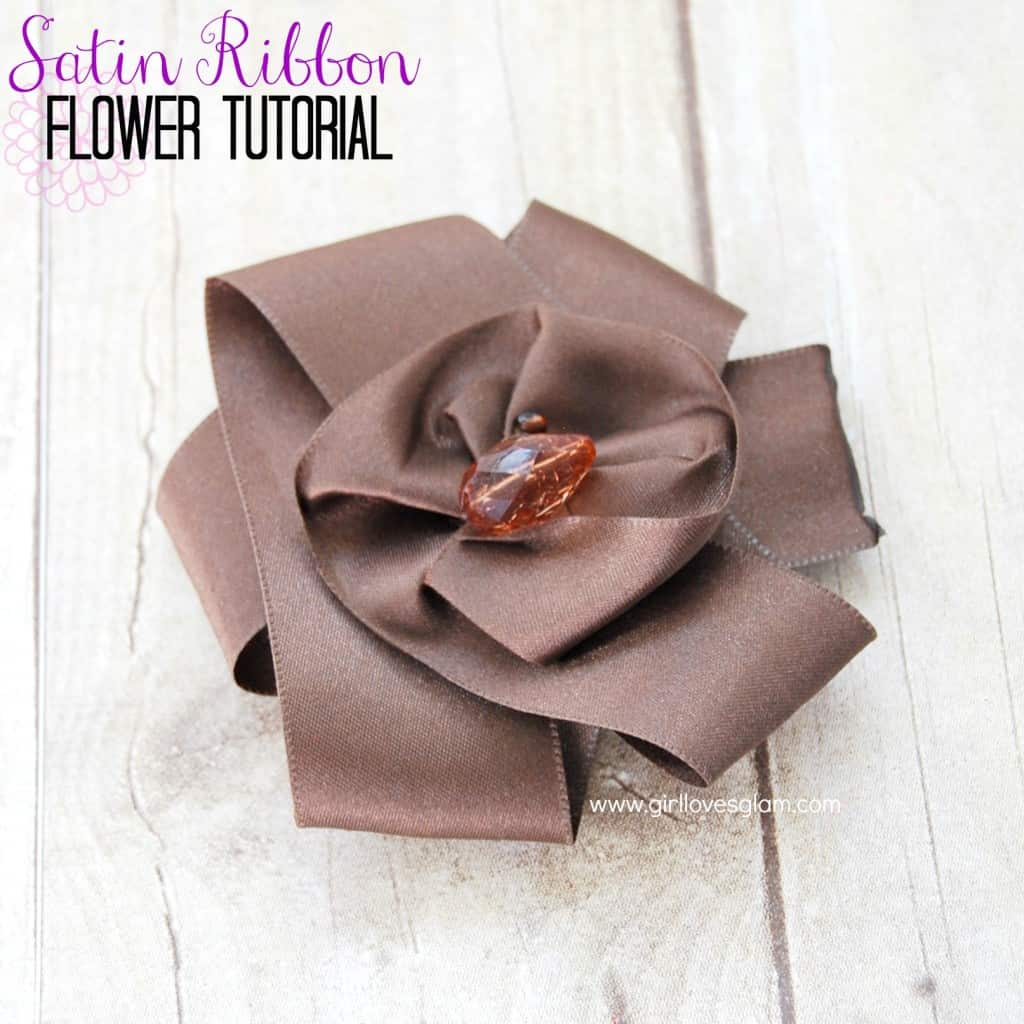 How to make a flower out of satin ribbon on www.girllovesglam.com #diy #tutorial #flower #accessory
