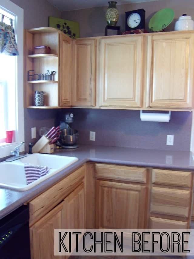 Kitchen before makeover on www.girllovesglam.com