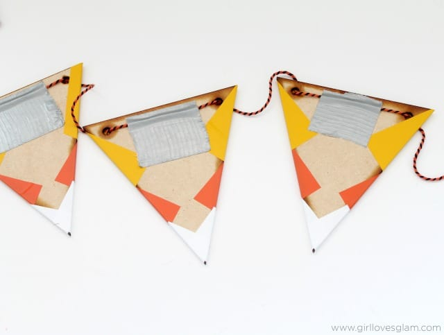 DIY Candy Corn Bunting on www.girllovesglam.com