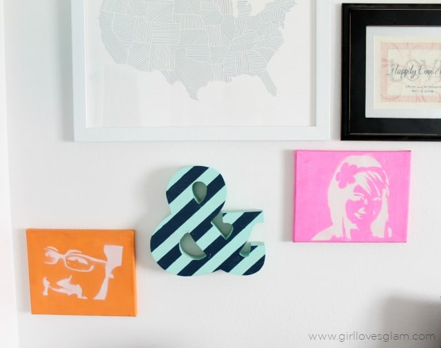 Stenciled portraits and striped ampersand corner gallery wall on www.girllovesglam.com