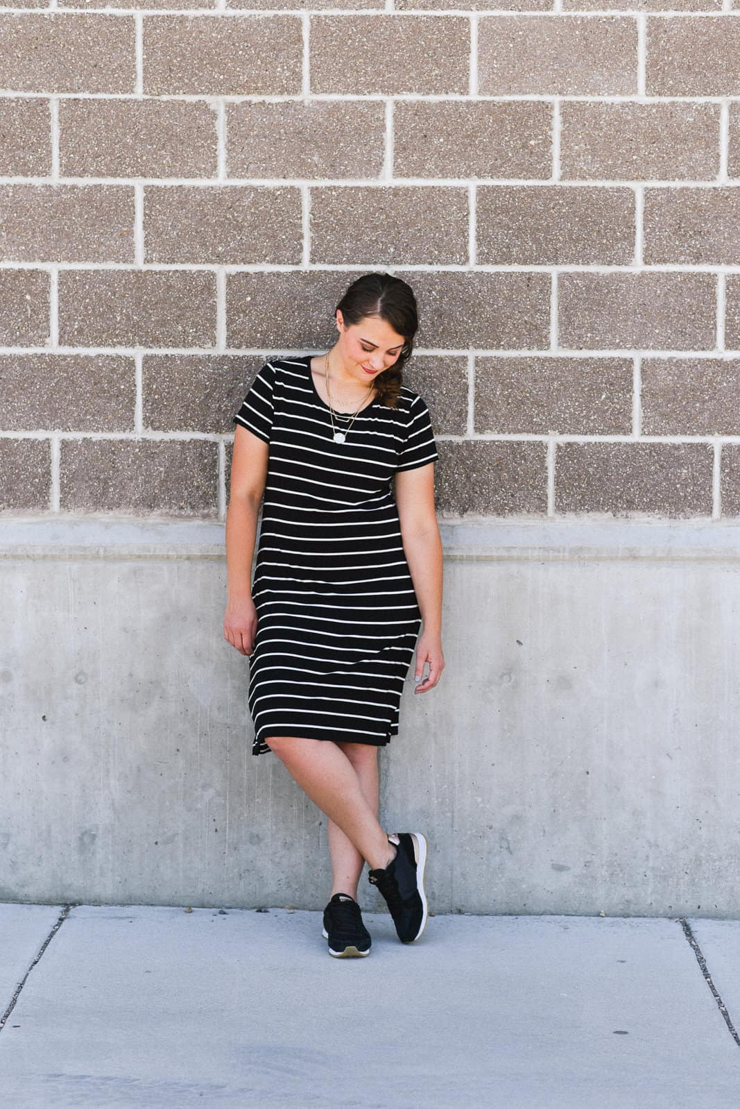 Wearing sneakers with a dress on www.girllovesglam.com