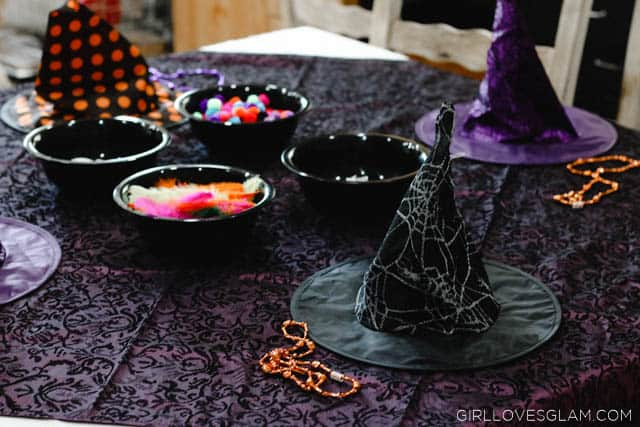 Witch Hat Decorating Halloween Party on www.girllovesglam.com
