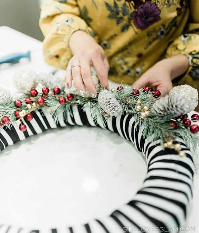 Decorating a Christmas wreath